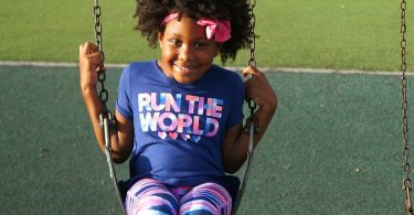 Active girl plays in her OshKosh Bgosh active wear