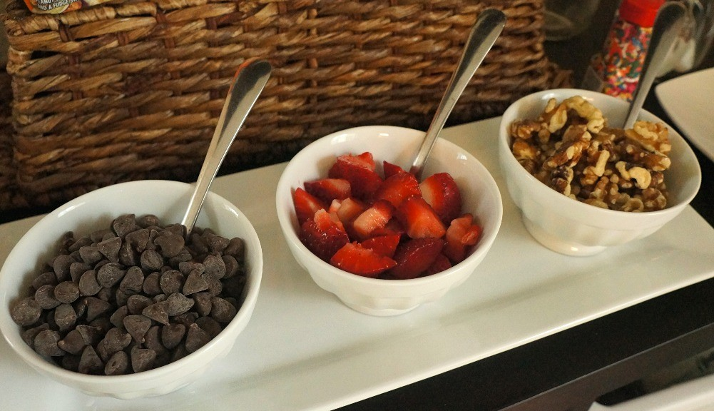Ice cream bar toppings chocolate chips strawberries and walnuts