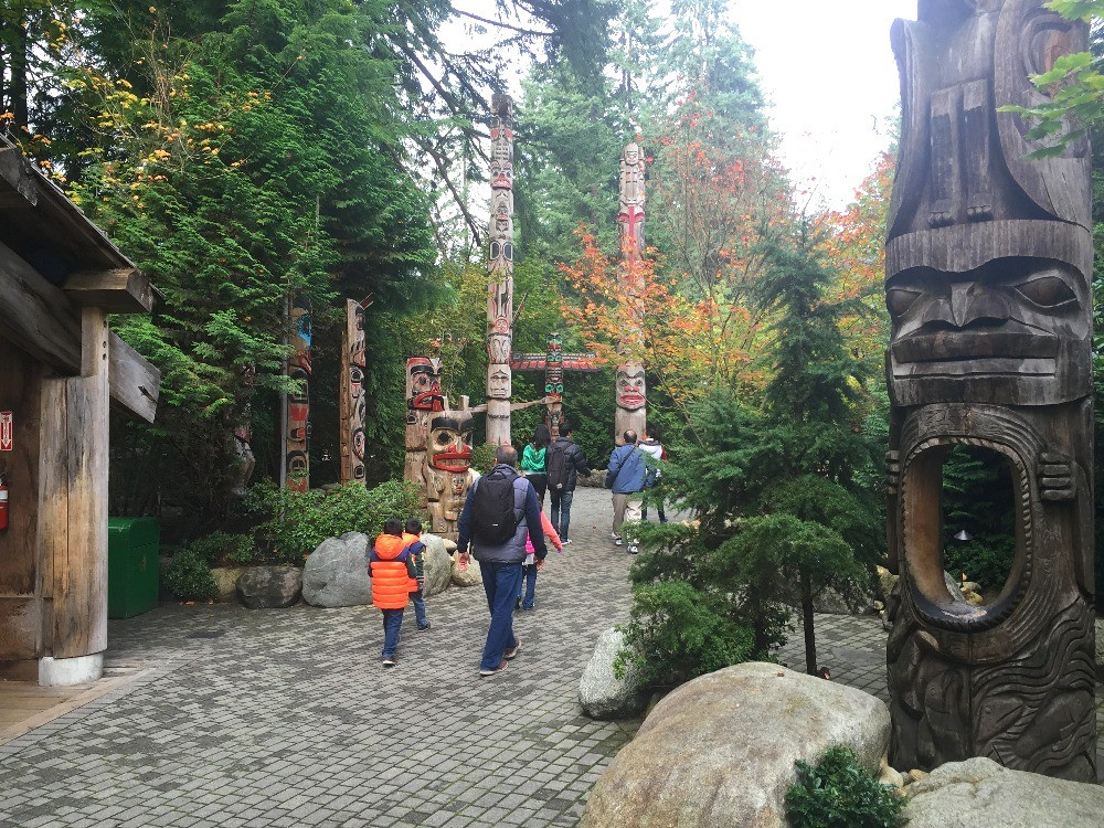 Totem poles and tiki statues at Capilano Suspension Bridge Park Vancouver