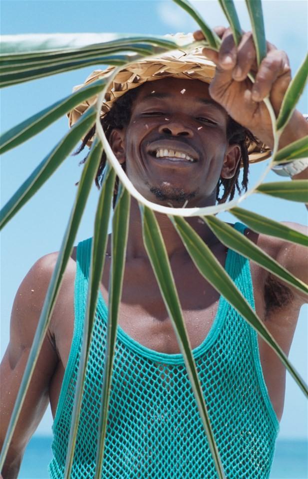Antigua and Barbuda photos, Local man handcrafts on the beach