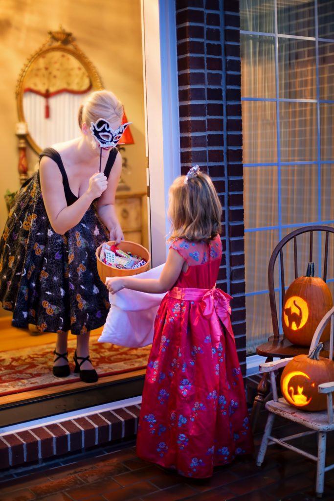 little girl princess costume trick or treating on halloween