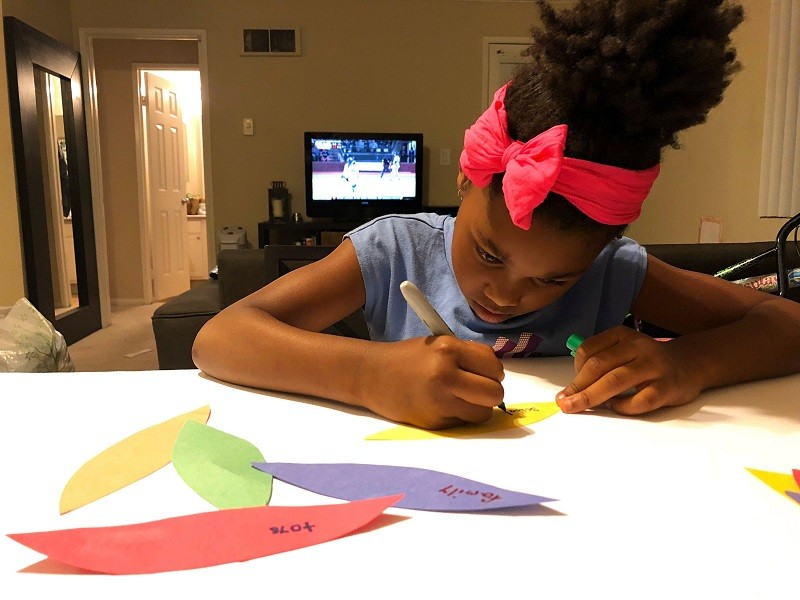 Girl making a thankful turkey Thanksgiving crafts for kids