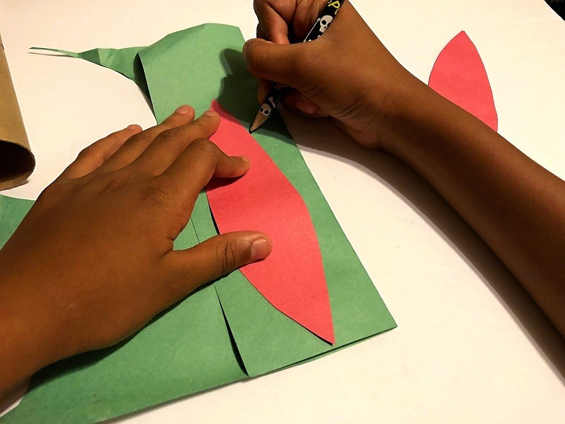 Tracing turkey feathers on construction paper
