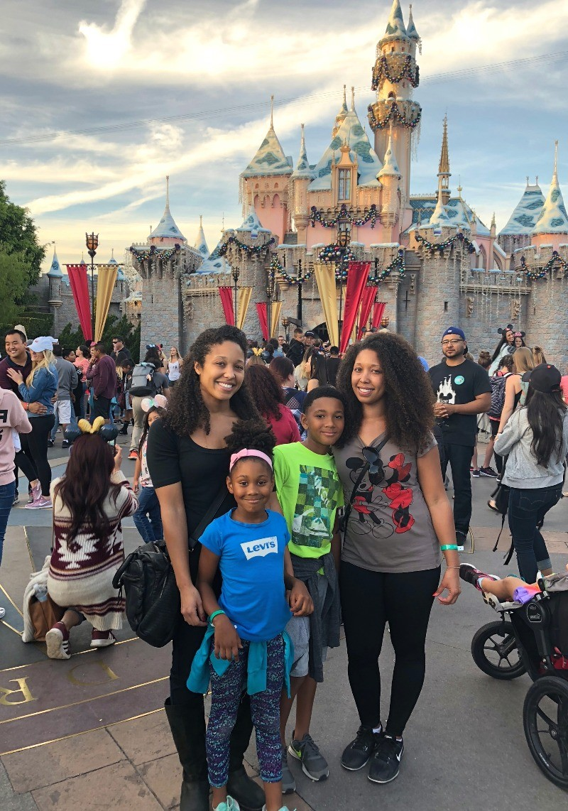 Family photo in front of the castle at Disneyland Holidays
