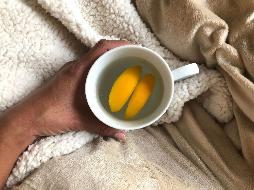 Cup of lemon water with honey