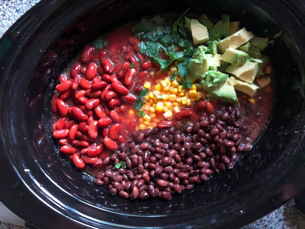 Ingredients in crock pot for southwest chicken and black bean chili recipe