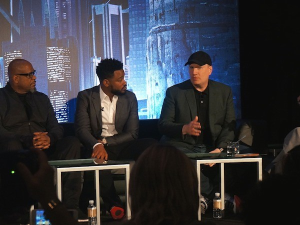 Marvel President Kevin Feige speaks on stage with the Black Panther cast at the press conference
