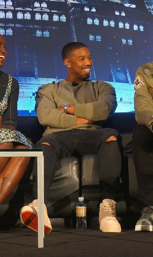 Michael B Jordan on stage at the Black Panther media event