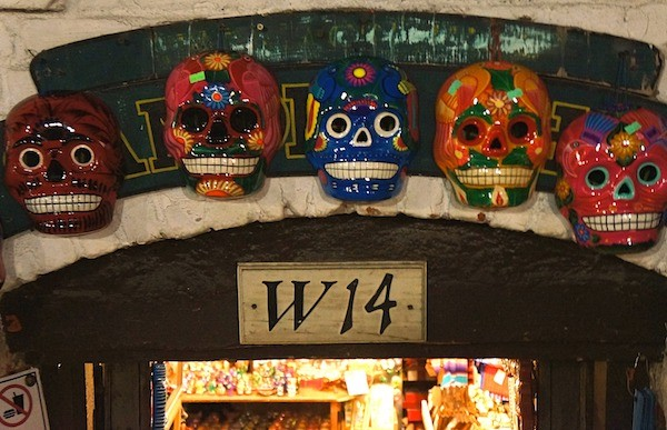 Skeleton faces line the doorway of a shop on Olvera Street Los Angeles