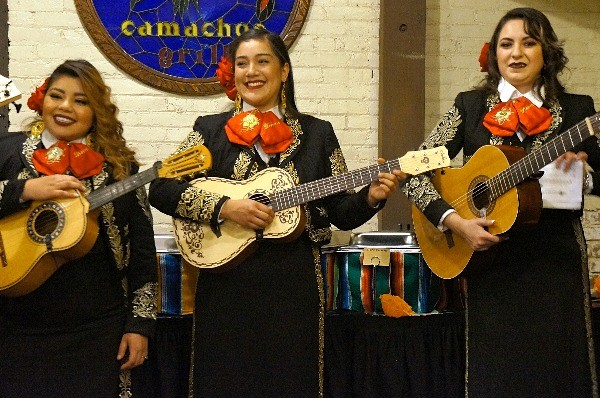 Traditional Mexican female band plays at El Paseo Inn restaurant on Olvera Street, Los Angeles, CA