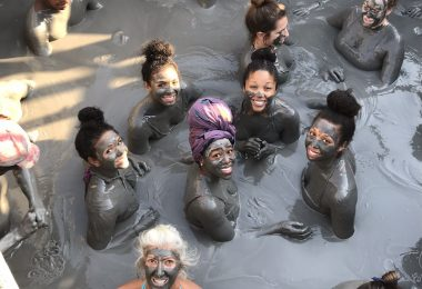 Girls in El Totumo mud volcano in Cartagena, Colombia