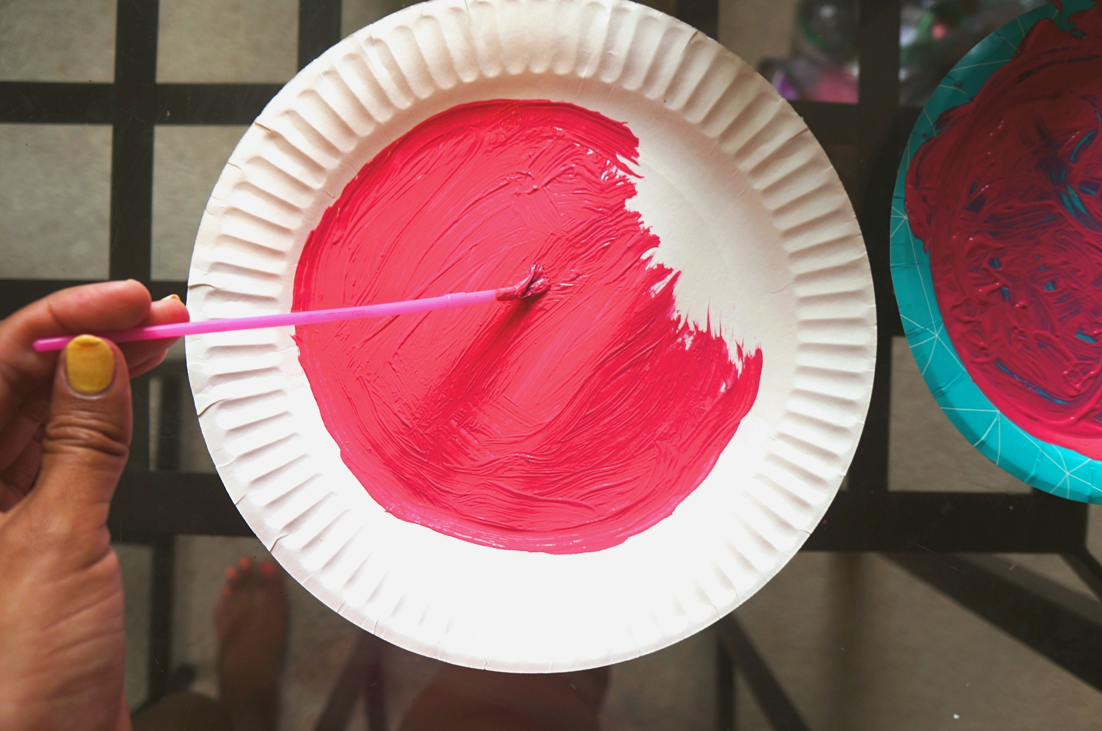 Painting paper plate watermelon pink