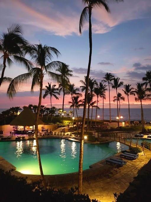 Sunset over the pool at the Hilton Waikaloa Resort on the Big Island of Hawaii - Deanna Underwood, Honey + Lime